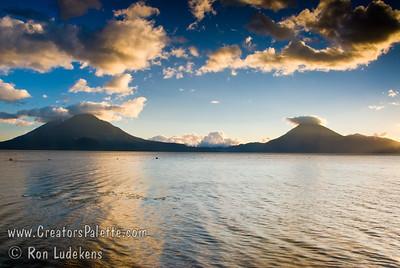 Guatemala Mission Trip - Day 7 - Thursday, November 15, 2007 Sunset over Lake Atitlan from Panajachel, Guatemala.   Toliman Volcano with Atitlan Volcano behind it on left, San Pedro Volcano on right.