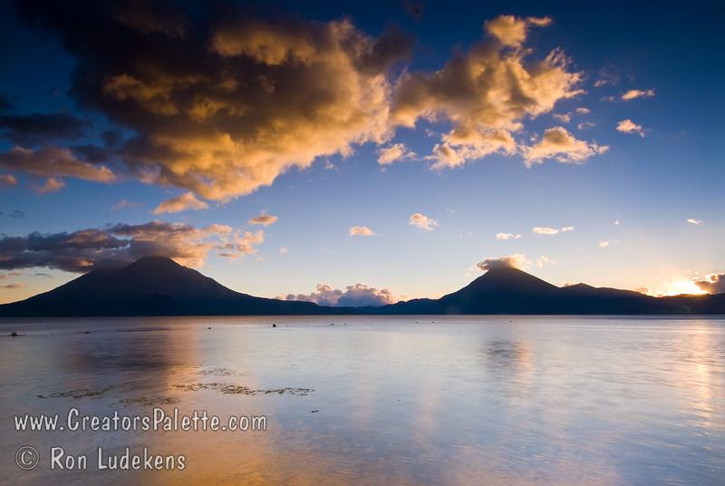 Guatemala Mission Trip - Day 7 - Thursday, November 15, 2007<br /> Sunset over Lake Atitlan from Panajachel, Guatemala.   Toliman Volcano with Atitlan Volcano behind it on left, San Pedro Volcano on right.
