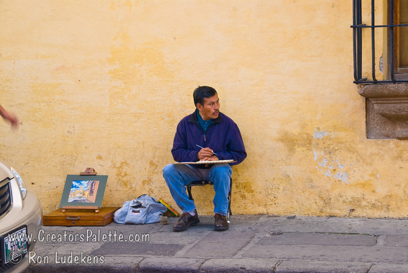 Guatemala Mission Trip - Day 8 - Friday, November 16, 2007   <br /> Artist sketching and painting Arch of Santa Catarina to sell to tourists.  Antigua Guatemala.