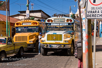 """Guatemala Mission Trip - Day 8 - Friday, November 16, 2007    School bus next to """"Chicken"""" bus in Solola."""