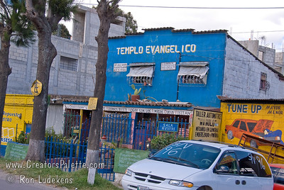 Guatemala Mission Trip - Day 8 - Friday, November 16, 2007    Along both sides of the road in Chimaltenango are miles of auto and truck repair businesses.  This little church was between the auto shops.