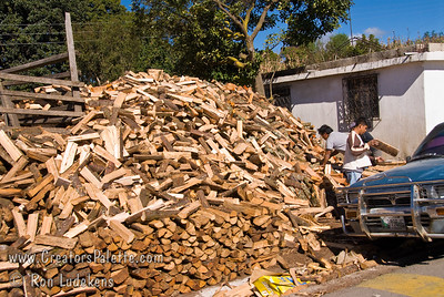 Guatemala Mission Trip - Day 8 - Friday, November 16, 2007    Very few local Guatemalans can afford gas or electricity to cook with.  Cooking and heating is done on wood fires.  Everywhere you go you see men, women and children cutting and hauling wood.  Here is a store that sells wood.
