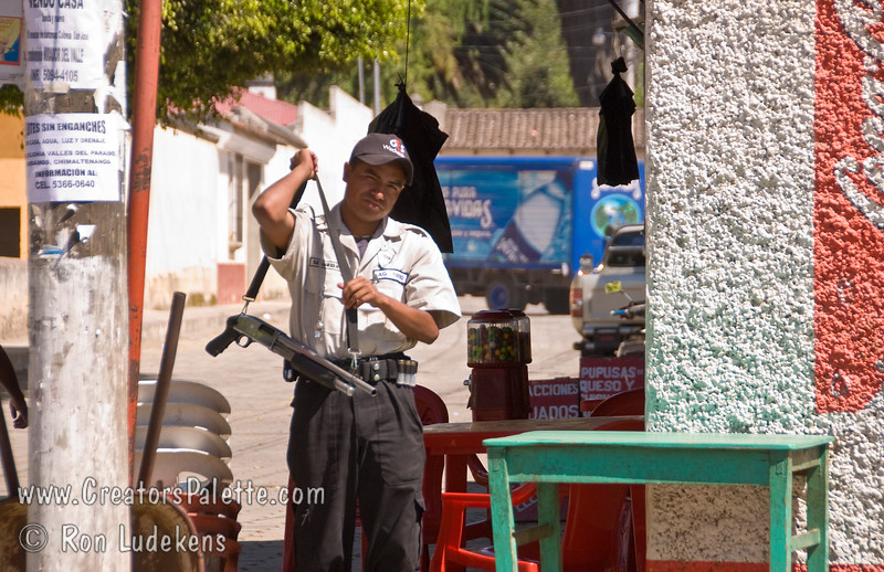 Guatemala Mission Trip - Day 8 - Friday, November 16, 2007<br /> A security guard carrying a short handled shotgun.  Seemed to be a lot of them around Antigua.
