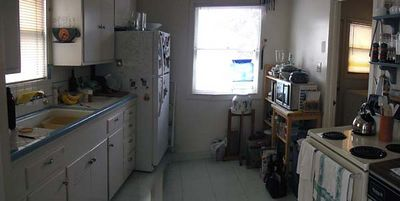January 2005  This is the kitchen before remodeling.  It's an efficient space, but short on counter space (8 sq. ft total!), no dishwasher, and no counters near the stove.  A great big sink, though!  I've been planning a remodel of this kitchen ever since I bought the house in 1994.