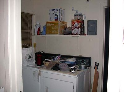 And the teeny tiny laundry space that shares the entry to the back yard.