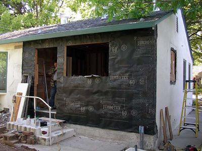 May 21, 2005.  Sheathing and tar paper.... still waiting for the door and windows.