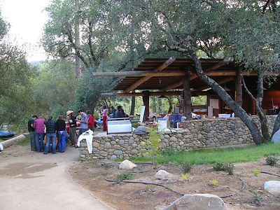 Gathering and preparing for dinner in the outdoor kitchen.