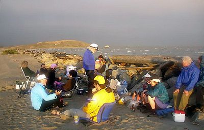 Potluck dinner in the wind lee.  Look at the whitecaps out there... they never died down after dark.
