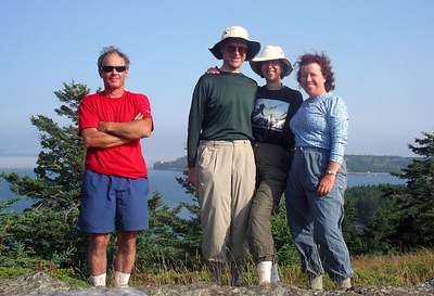 We climb to the top of Butter Island, where there is a monument to the Cabot family, to whom this island belongs.  Their decendents have been kind enough to open a portion of the island up to MITA members.  Behind us is the lighthouse on Eagle Island.