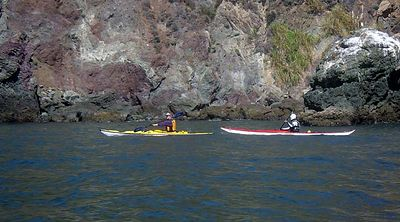 Ediko and Dave head toward Bonita Cove with a backdrop of Doerte's geological study.
