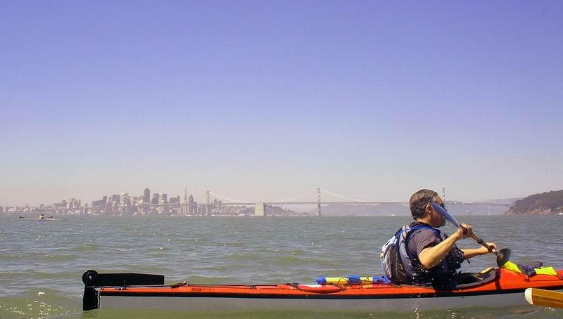 Craig sillhouetted against the city skyline.