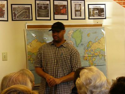 Gabriel, our tour host, in front of a map of the world where ingredients come from.