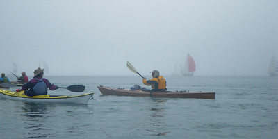Sailboat regatta in the fog.