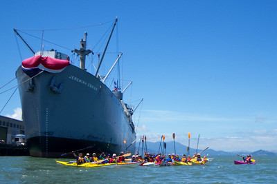 Celebrating a great day on the water, before paddling the last leg, around the breakwater in to Aquatic Park.