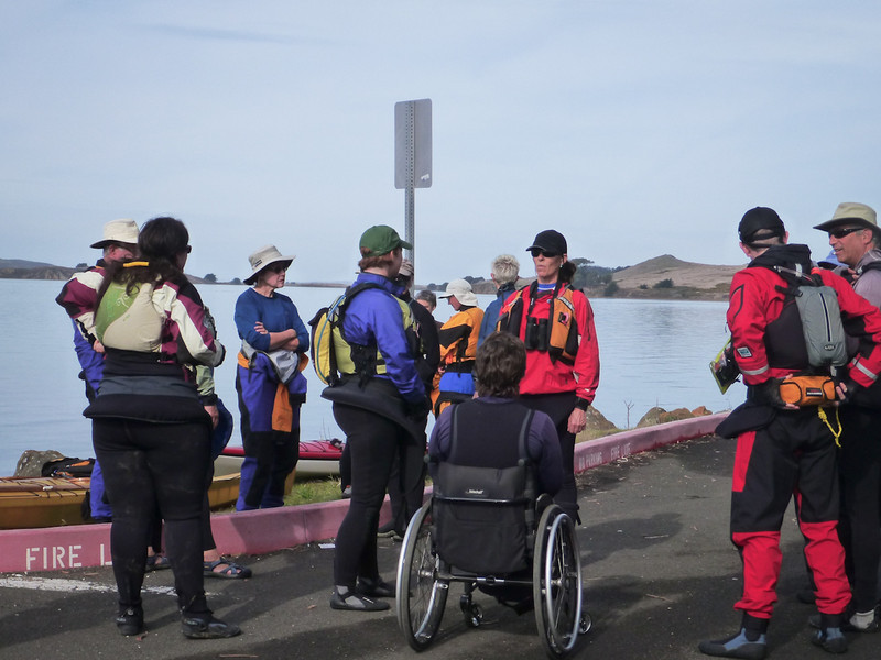 Paddlers gather up, anticipating a thorough safety talk, delivered by Nathan.