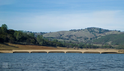 This is the former Salmon Falls Bridge, on Folsom Lake.  Usually, it's under water, but our winter has been exceptionally dry, and the expected water from the snowpack is non-existent so far.  This bridge used to span the low water crossing of the south fork of the American River.  In the late 1950's, Folsom Dam was built, forming Folsom Lake, and combining the north and south forks of the American River.  I was able to paddle under and then walk on this bridge yesterday - it's in surprisingly good condition!