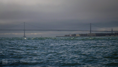 The SF-Oakland Bay Bridge, with choppy waters.