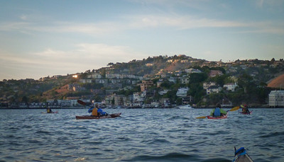 22 paddlers made the eddy line turn by the green bouy to find smooth seas in Racoon Strait.