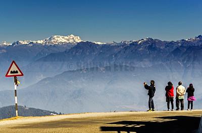 C9:Tourists watching Gangkar Puensum, the highest peak in Bhutan,from Dochula Pass