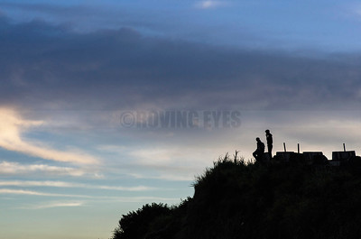 C18:Friends watch the day end at the roadside viewpoint in Rohini,West Bengal