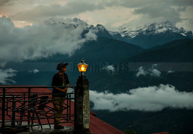 C12:The majestic Khangchendzonga range as seen through the clouds on a monsoon evening from Pelling in West Sikkim.