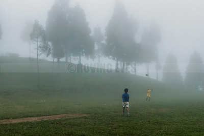 C6:A couple of local boys practice football amidst dense fog in Deolo Hill,Kalimpong,West Bengal