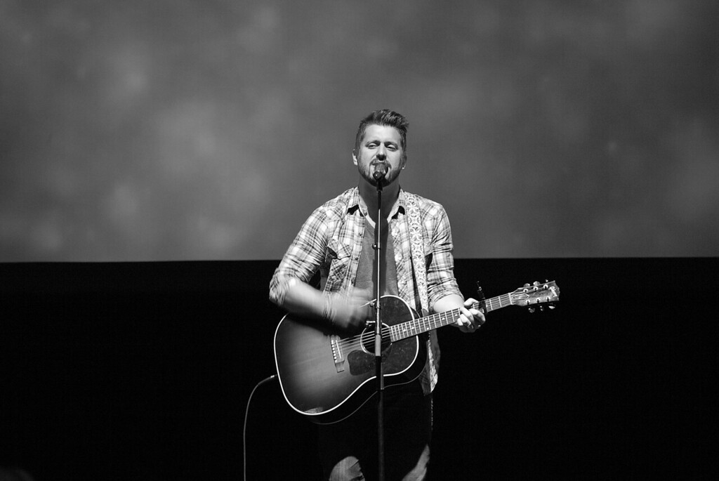 Travis Collins leading worship at the Grove on Sunday April 15, 2012.