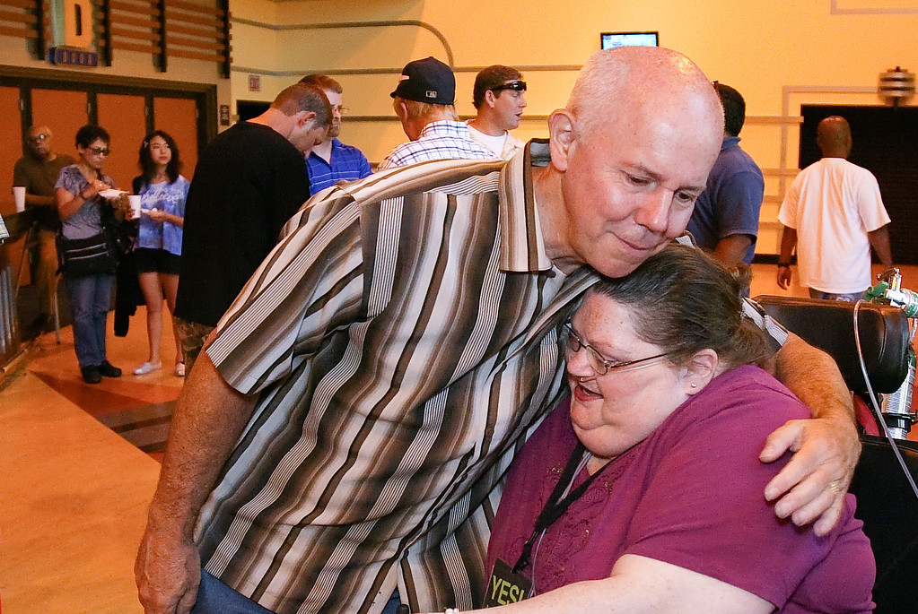 Pastor Tom Holladay gives Kathleen Tyler a hug at the Grove on Sunday July 8th 2012.