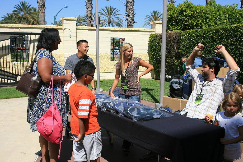 Lawren and Summer Ramos at the Op[eration Backpack table on Sunday July 29, 2012.