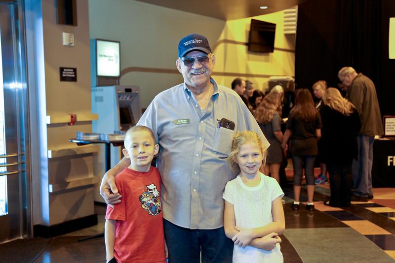 Joe Farce with his grandchildren