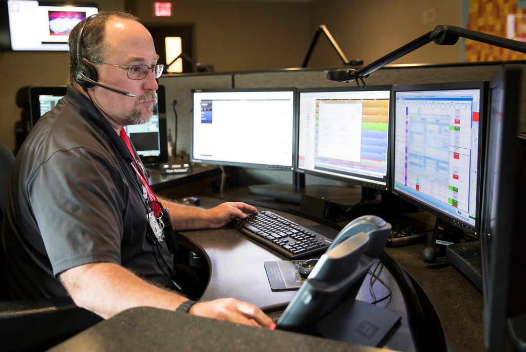 Critical Care Transport Communication Specialist Mark Chipman monitors LifeLine in both the air and on the ground at the IU Health LifeLine Operations Center in Speedway. The LifeLine facility in Speedway functions as the communication center, base for ground ALS/BLS operations, and training facility. (IU Health/Evan De Stefano)