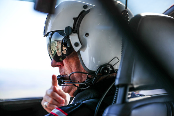 LifeLine Pilot Jay Burleson looks out the window of the helicopter somewhere over northern Indiana on June 6, 2017. Jay was flying the LifeLine helicopter to Forte Wayne for a patient transport to Riley Children's Hospital. (IU Health/ Evan De Stefano)