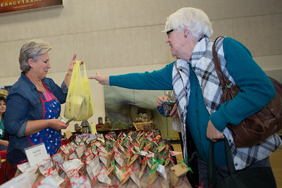 Pat Pajek of Weatherford buys sweet and savory mixes from the Sandee's Simply Homemade booth.