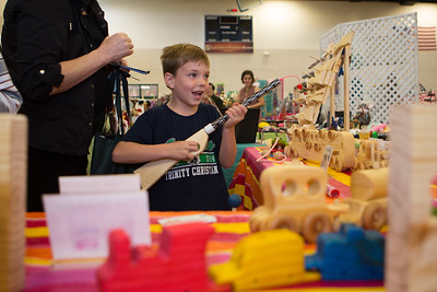Cameron Hobbs of Benbrook tries out a pop gun at John's Wooden Toys booth.