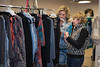 Ginger McKee of Aledo (right) shops at Lisa Leach's clothing booth.