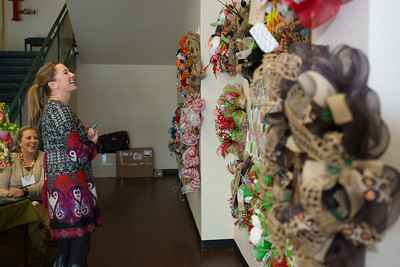 TCA volunteer Amy Quinn shops for a holiday wreath.