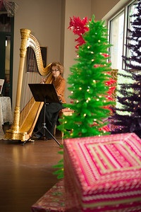 Harpist Sydney Howell brings holiday music to the festive atmosphere.