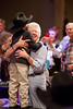 Marti Leonard collects a $3000 hug from cancer survivor Hayden Head. The hug was one of many items auctioned to raise money for palliative and end-of-life care at Cook Children's Hospital.