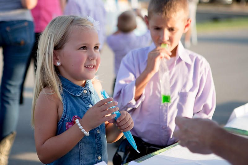 Aurora and Joshua Casey cool off with free ice pops.