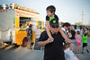 Quinn Mahoney enjoys a ride from his father Mark near the food trucks at First Friday.