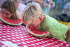 Benjamin Farmer and Rayanna Mauldin compete in the watermelon eating contest. Benjamin won  the contest in his age group.