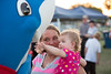 Emma Jane Britton reaches out to a shark costumed character with her aunt April Deemer.