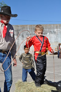Weatherford Hometown Heritage Stampede Oct. 27, 2012 - Johnny Davis teaches roping technique to Preston F.