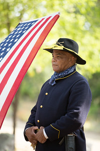 Sam Allen, Commander of the North Texas Buffalo Soldiers, stands at attention during the dedication cermony.