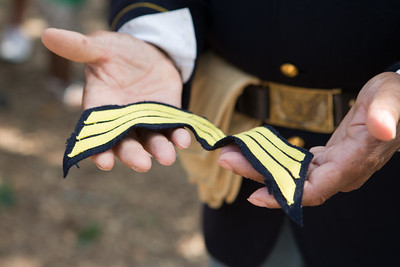 Sam Allen carries officer's stripes because the Buffalo Soldier he portrays only wore them during battle.