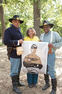 Sam Allen, Evelyn Loudres and Paul Allen with a poster of Lawson Gratz.