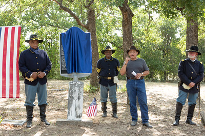 Josef Gratts speaks at the dedication of his great grandfather Lawson Gratts' Historical Marker with   members of the North Texas Buffalo Soldiers (From left: Commander  Sam Allen, Paul Allen and Jack Dyess).