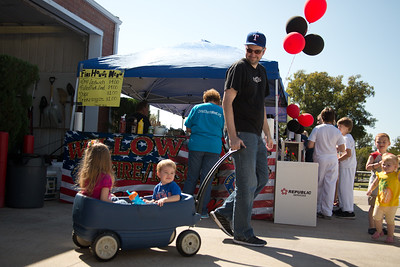 Claire and Adam Ashby  of Willow Park are pulled in a wagon by their father Ryan.