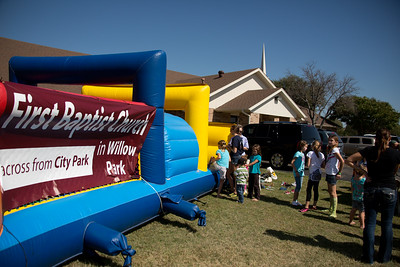 Children wait to climb on the inflatable at First Baptist during Willow Park Fest.