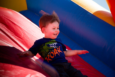 Coy Wilhite slides down the inflatable wall at First Baptist Church of Willow Park during Park Fest.